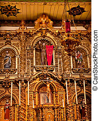 Spanish Ornate Golden Altar Serra Chapel Mission San Juan Capistrano Church in California. Father Junipero Serra founded the Mission in 1775, and the altar is 300 years old from Barcelona, Spain.