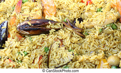 Spanish paella with mussels and yellow rice and seafood