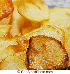 spanish patatas fritas, french fries - closeup of a plate...