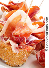 spanish pinchos de jamon, serrano ham served on bread -...