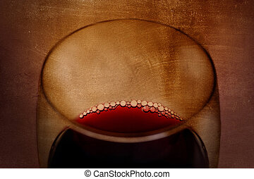 Spanish red wine Glass with bubbles on grunge arty background