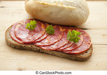 Spanish salamis with bread roll
