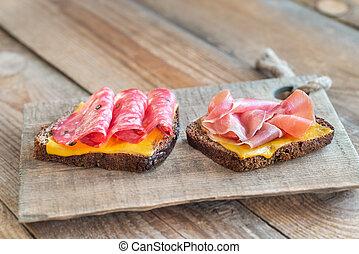 Spanish sandwiches with salchichon anb jamon