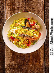 Spanish Seafood Paella in White Bowl on Table