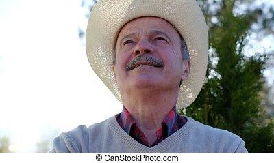 Spanish senior man in hat relaxing outdoor - Spanish happy...