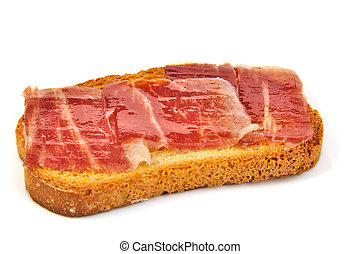 Spanish serrano ham on bread slice. White background. Tapa.