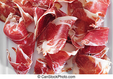 spanish serrano ham served as tapas