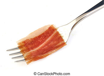 Spanish serrano ham slice on metal fork.