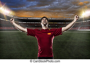 Spanish soccer player, celebrating with the fans.