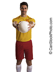 Spanish soccer player holding ball on white background