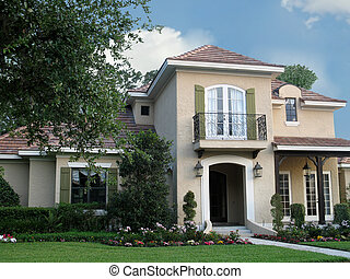 beautiful, upscale Spanish-style architecture with landscaped lawn