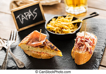 Spanish tapas - Delicious spanish tapas and beer served on a...