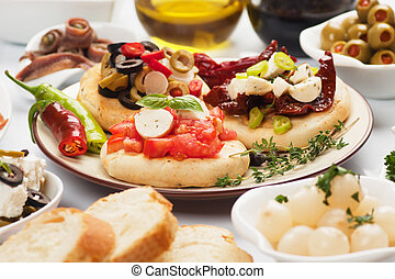 Spanish tapas food - Tapas with cheese, tomato, olives,...