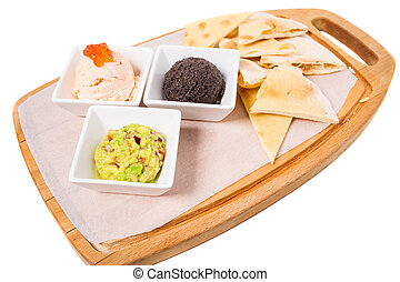 Spanish tapas platter with various pates.
