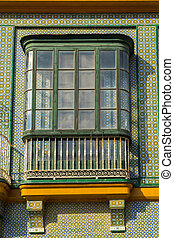 Spanish tile and wood facade