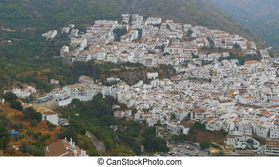 Spanish white village of Andalusia surrounded by mountains...