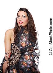 Spanish woman behind traditional fan. - A Spanish beautiful...