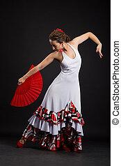 Spanish woman dancing flamenco on black - Flamenco dancer in...