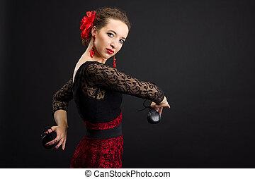 Spanish woman dancing flamenco on black - Professional...