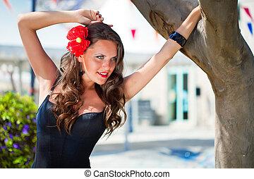 Spanish woman in black dress