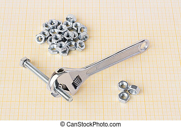 Spanner, bolt and nuts on graph paper
