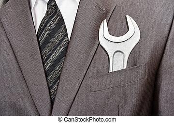 Spanner in businessman suit pocket