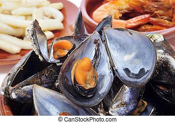 spansih seafood tapas - closeup of some seafood spanish...
