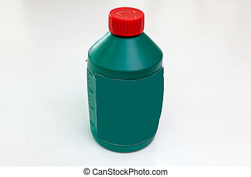Spare part for car stop system brake fluid one liter bottle in green color with red cap on a white isolated background. Maintenance and oil change in auto service industry.