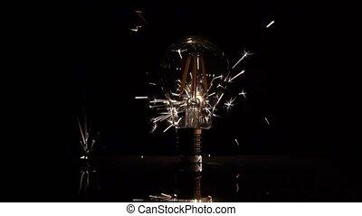 Sparkler Behind LED Light Bulb - Lower Half in Slow Motion.