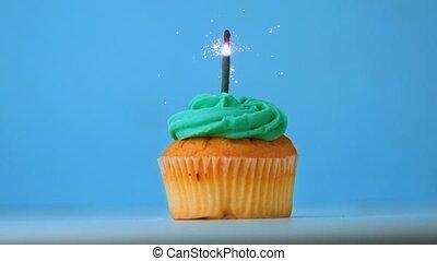 Sparkler burning on blue birthday c
