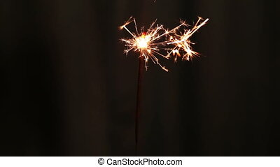 sparkler burning on dark background