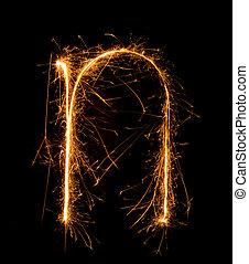 Sparkler firework light alphabet n (Small Letters) at night...