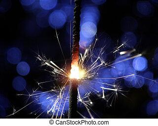 sparkler making fireworks - Sparkler making white and blue...