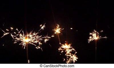 Sparkler on black background. Clouse up - Beautiful sparkler...