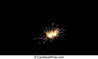 Sparkler on black - Sparkler burning on black background