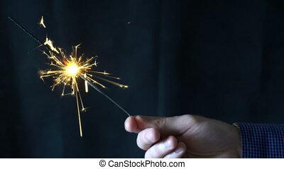 Sparkler Over Black HD . Gun powder sparks shot against deep dark background. Ambient audio included