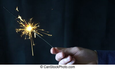 Sparkler Over Black HD . Gun powder sparks shot against deep dark background. Ambient audio included