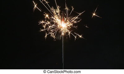 Sparkler, slow motion - Sparkler burning down, slow motion...