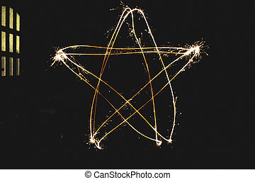 Sparkler Star Shape - Star shape made with a sparkler in a...