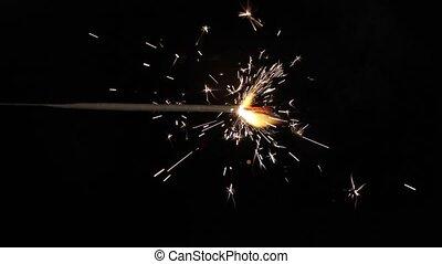 Sparkler - This video shows a burning sparkler.