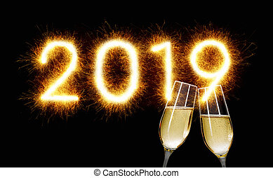Sparkler with champagne glasses - Happy New Year 2019