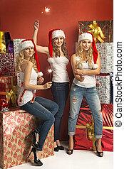 sparklers, deslumbrante, três, segurando, mulheres