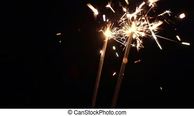 Sparklers slow mo. Christmas and New Year lights. -...