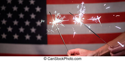 sparkles in front of  American flag