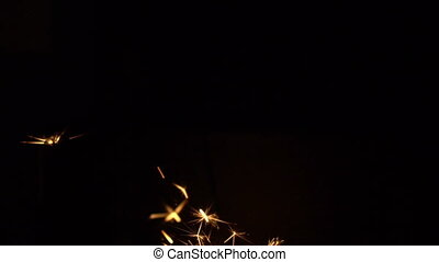 Sparkles of bengal fires at black background