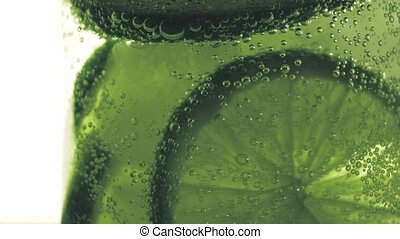 Sparkling bubbles water with a slice of lime