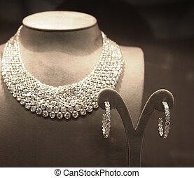 Sparkling Diamond Necklace and Pair of Earrings on Display in Store Window
