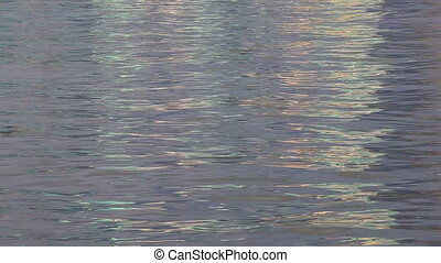 Sparkling fresh wavy water is shining on a sunny summer day,...