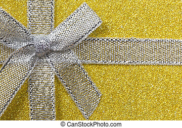 Sparkling gift box or present with bow ribbon on magic Background with glitters Copy space for greeting text. pink and Yellow