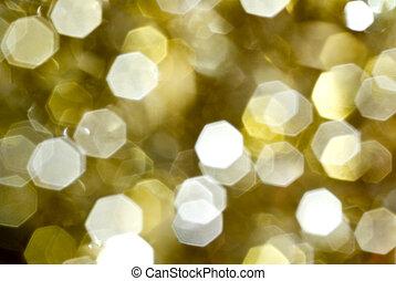 sparkling gold - lens bokeh effect of a christmass ...